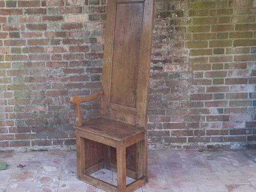 Tall one armed oak Monastery Chair