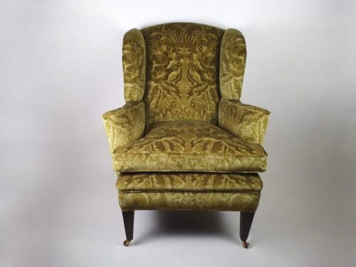 Large, generously proportioned Victorian Wing Backed Armchair, recovered in green velvet