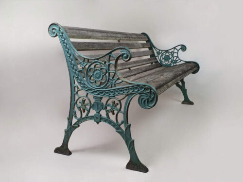 19th century cast iron ornate Victorian garden bench in old turquoise paint