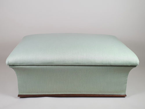 Victorian concave Ottoman, reupholstered in a peppermint geometric fabric